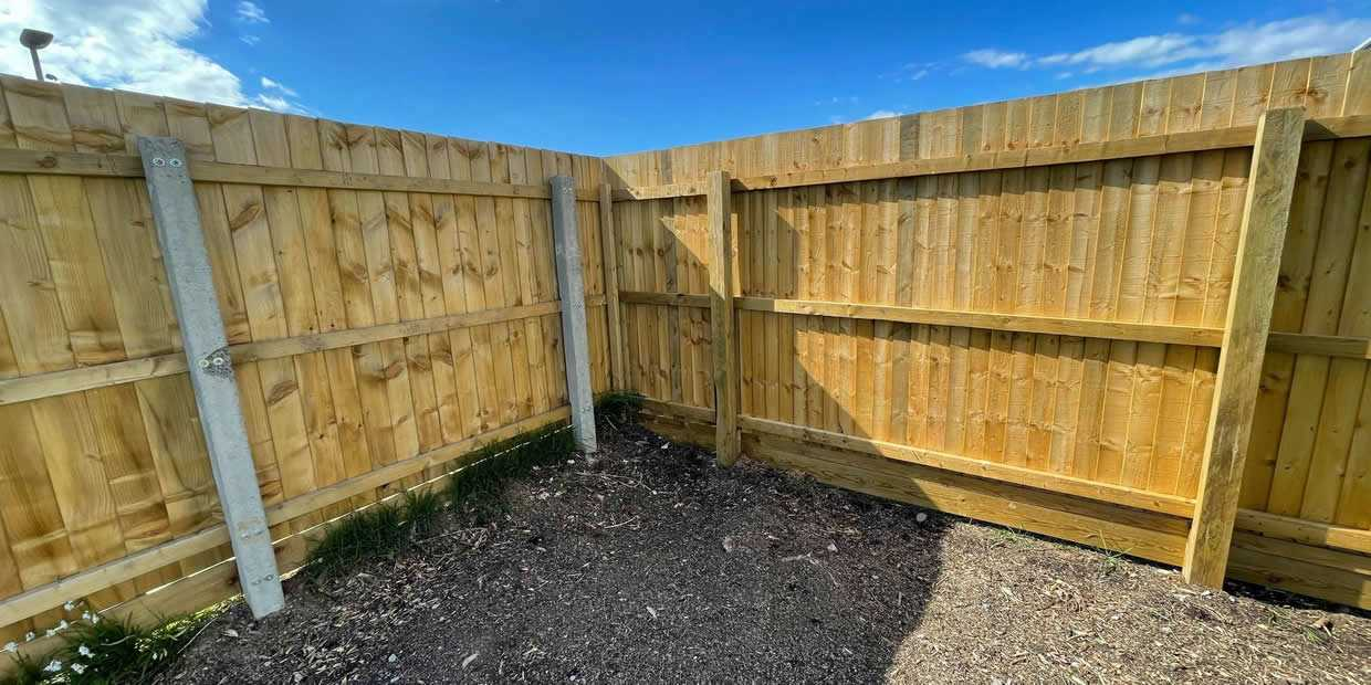 concrete or wooden fence posts